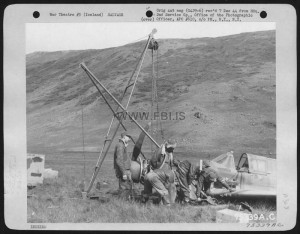 Members Of The 2Nd Service Group Hoist Salvaged Of A Wrecked Curtiss P-40 Onto A Truck, Somewhere In Iceland. 26 August 1943.