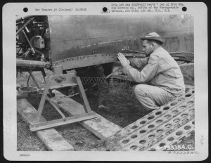 Members Of The 2Nd Service Group Salvage Usable Parts From A Curtiss P-40 Somewhere In Iceland. 26 August 1943.