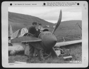 Members Of The 2Nd Service Group Salvage Usable Parts From A Curtiss P-40 Somewhere In Iceland. 26 August 1943. Fitjar skorradal